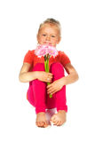 Lovely blond girl with flowers Stock Images