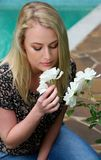 Lovely Blond Lady and Flowers Stock Image