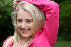Lovely Blond Lady in Pink Jacket Royalty Free Stock Photos