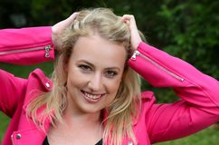 Lovely Blond Lady in Pink Jacket Stock Images