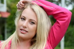 Lovely Blond Lady in Pink Jacket Royalty Free Stock Image