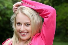 Lovely Blond Lady in Pink Jacket Stock Image