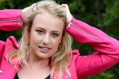 Lovely Blond Lady in Pink Jacket Stock Photo