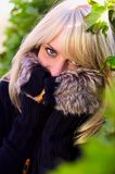 Lovely blond woman looks and hides Royalty Free Stock Images