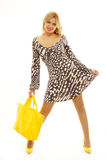 Lovely blond woman with yellow bag Stock Image