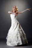 Lovely blonde bride dressed in elegant attire Stock Images