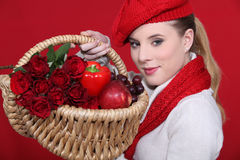 Lovely blonde carrying basket Royalty Free Stock Photo