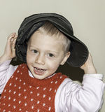 Blond child smiling to the camera stock photos
