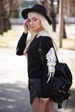 Lovely blonde girl in posing outdoors Stock Image