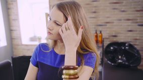 Lovely blonde lady at beauty salon stock video footage
