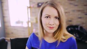 Lovely blonde lady at beauty salon stock footage