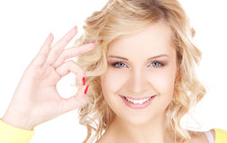 Lovely blonde showing ok sign Stock Photos