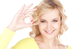 Lovely blonde showing ok sign Stock Images