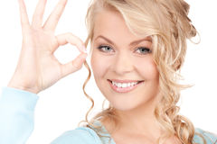 Lovely blonde showing ok sign Royalty Free Stock Photo