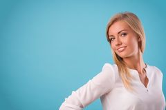 Lovely blonde wearing white blouse Stock Image