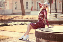 Lovely blonde young woman in posing outdoors Royalty Free Stock Images