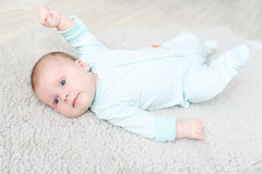 Lovely blue-eyed 1 months baby. Portrait of lovely blue-eyed 1 months baby royalty free stock image