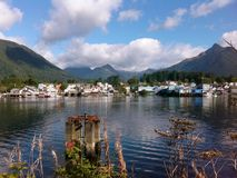 Sitka harbor in September. Lovely blue skies  with big puffy clouds and reflective blue water at the Sitka harbor in September Royalty Free Stock Images