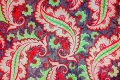 Lovely botanic paisley pattern. A close up of a colorful printed shabby chic  paisley pattern in red, green and grey Stock Photos