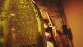 Lovely Bottle. Crisp image of a beautiful olive oil bottle with beautiful bubbles Royalty Free Stock Image