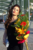 Lovely with bouquet kissing pose Stock Images