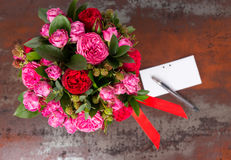 Lovely bouquet of pink roses with gift tag and red ribbon in a c. Oncept of love, romance, anniversary, Valentines day or wedding Stock Images