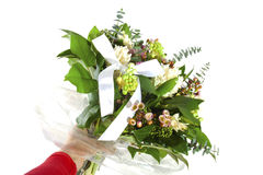 Lovely bouquet for someone special. Beautiful bouquet in human hand with different flowers over white Stock Photo