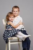 Lovely boy and girl hugging Stock Images