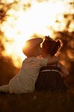 Lovely boy and girl on sunset Stock Photos