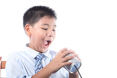 Lovely boy listen tin can telephone Royalty Free Stock Photos