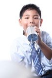 Lovely boy listen tin can telephone. In studio Stock Images