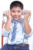 Lovely boy listen tin can telephone. In studio Stock Photos