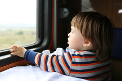 Lovely boy looks out of window in the train Stock Images
