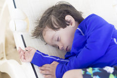 Lovely Boy Sleeping at the beach Stock Photography