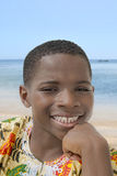 Lovely boy smiling at the beach, ten years old Stock Images