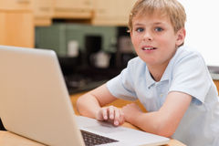 Lovely boy using a notebook Royalty Free Stock Images