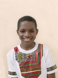 Lovely boy wearing a Ghanaian style t-shirt, ten years old Royalty Free Stock Photos