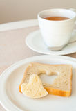 Lovely breakfast. Heart shaped toast bread and a cup of tea for breakfast Royalty Free Stock Photos