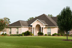 Lovely Brick Home. Nice brick home on sweeping lawn royalty free stock photos