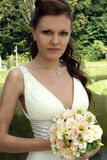 Lovely bride with bouquet royalty free stock image