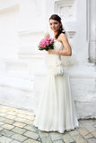 Lovely bride with bouquet from roses stock photo