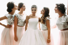 Lovely bride and bridesmaids next to the big window Royalty Free Stock Photos