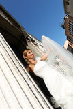 Lovely bride in the city sunny day flower bouquet Stock Images