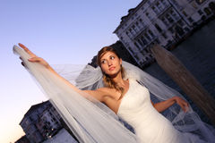 Lovely bride in the city sunny day flower bouquet Royalty Free Stock Image