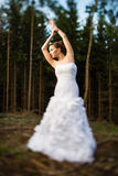 Lovely bride in a forest Royalty Free Stock Images