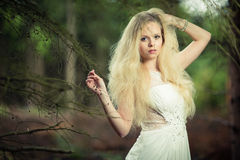 Lovely bride in a forest Royalty Free Stock Image