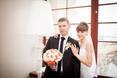 Lovely bride and groom in a beautiful room Royalty Free Stock Photo