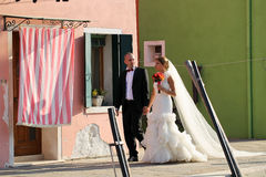 Lovely bride and groom in the city sunny day flower bouquet Stock Image