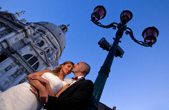 Lovely bride and groom in the city sunny day flower bouquet Royalty Free Stock Image