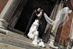 Lovely bride and groom in the city sunny day flower bouquet Stock Photo